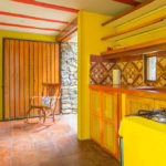 Kitchen and doorway to terrace of Gitsa Havansa at Finca Malinche, Nicaragua