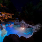 Night view of the poolside and Laguna side Rancho at Finca Malinche, Laguna de Apoyo, Nicaragua